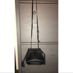 Black purse with fringe detail on the side